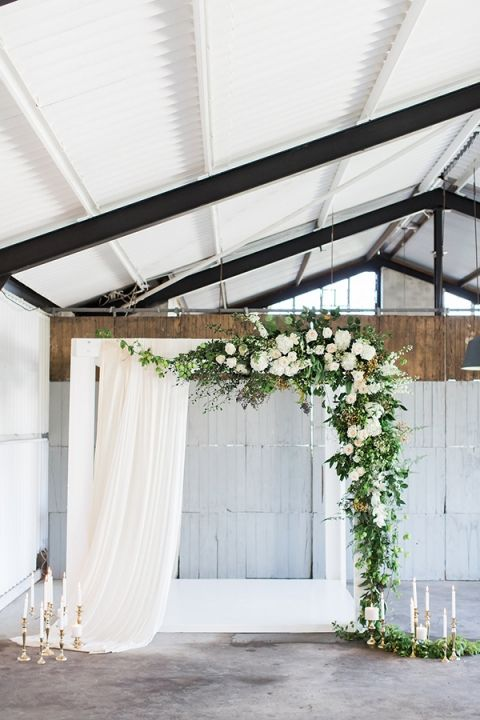Industrial Ceremony with Greenery Garlands and Ethereal Drapery | Wesley Vorster Photography | http://heyweddinglady.com/organic-greenery-wedding-inspiration/