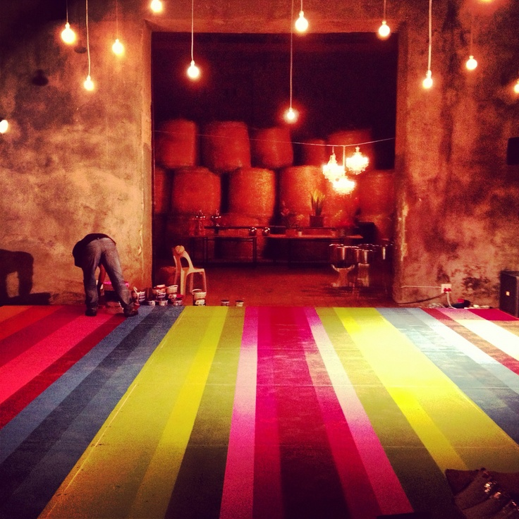 Finishing touches to multicoloured dance floor. Mayan inspired www.eventsandtents.co.za