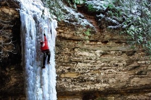 Ice Climber on frozen waterfall in Munising, Michigan by the south shore of Lake Superior.