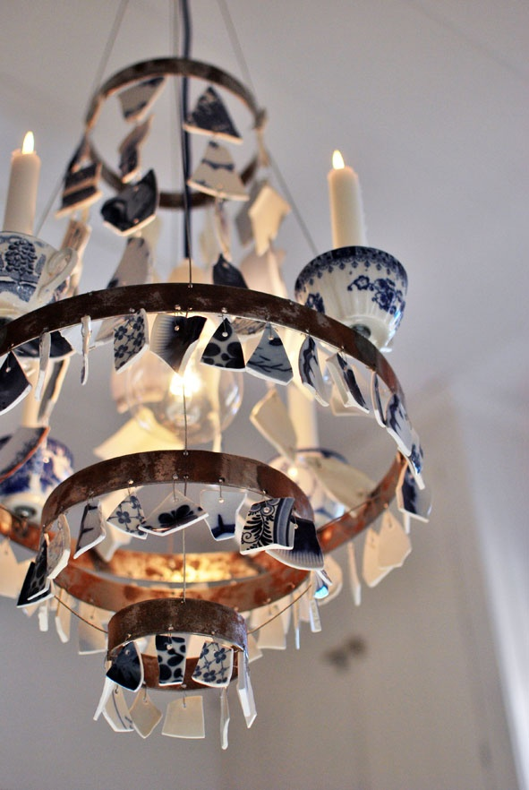 Using fragments of broken china to build this chandelier. Lovely recycling tip!
