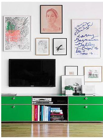 Can't decide if the one open wall in your apartment should be for the TV or artwork? Do both! You can playfully hide your TV by placing it among your framed art, making it appear as though it's part of a gallery wall!