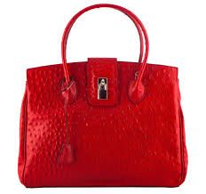 Classic red! It combines well with chocolate brown, taupe, grey, cream, black, white and navy.