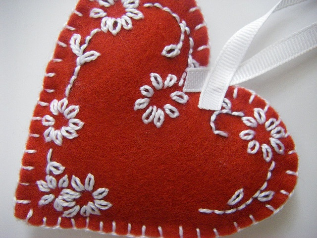 This cute heart would look great as a dangling purse decoration! The white embroidery is a great contrast on the red heart.
