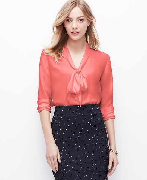 A quintessential staple in the season's prettiest colors, our luxurious crepe blouse is detailed with a tie neck for sophisticated allure. V-neck with self ties. Long sleeves with button closure. Back yoke. Shirttail hem.