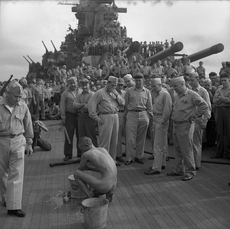 "Crew of the USS New Jersey watch as a Japanese prisoner of war is shaved, deloused and bathes himself, December 17 1944 [[MORE]] "" Crew of USS New Jersey (BB-62) watch as a Japanese prisoner of war is..."