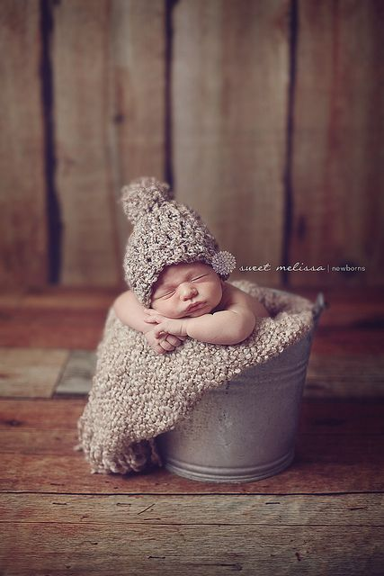 newborn photo in bucket/basket