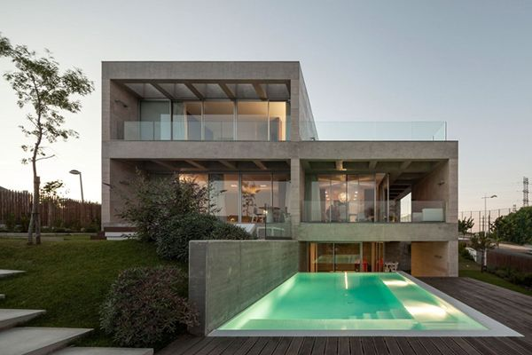 Modern Concrete House Softened By The Walnut Notes in Lisbon