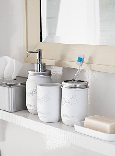 Exclusively from Simons Maison     Trendy storage jars updated in a resistant white resin to decorate the bathroom. Shiny silver metallic accents and embossed vintage typography on the front.