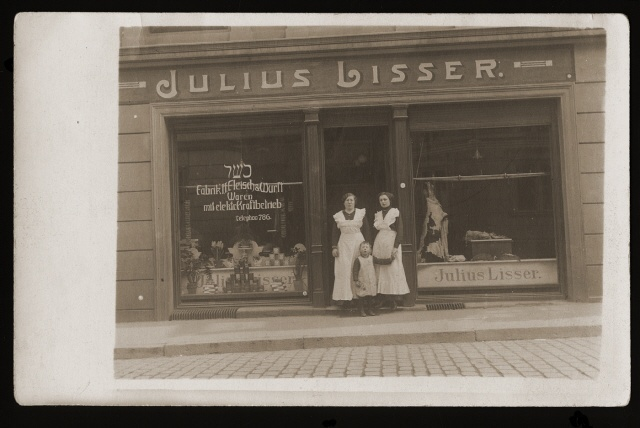 Members of the Lisser family pose in front of the Julius Lisser kosher butcher shop in Danzig