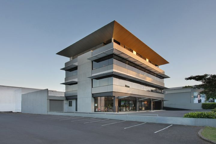 New commercial building with ground floor retail, offices and apartment above.