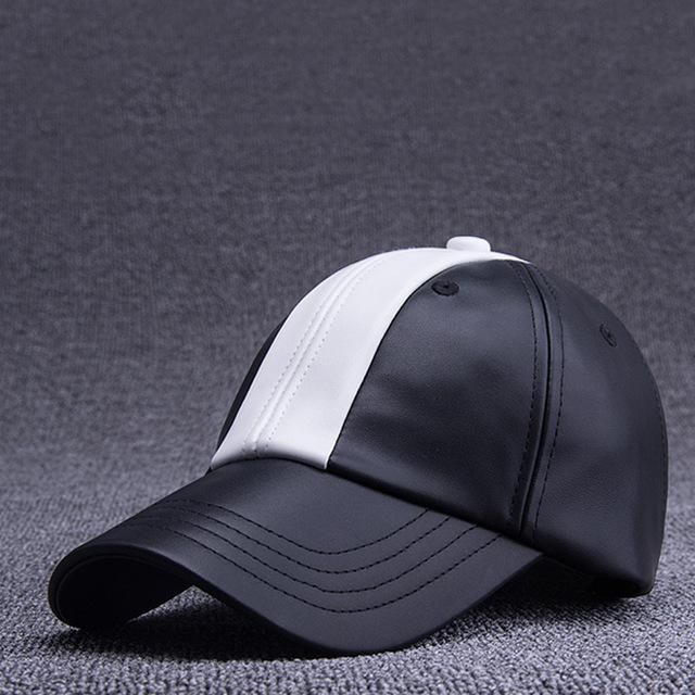 The new winter fashion peaked cap, men and women, outdoor sports cap, PU material, black and white baseball cap FB17047