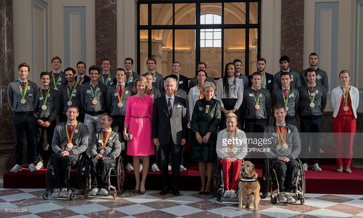 Queen Mathilde (1st row, 3R), King Philippe (C), Princess Astrid (1st row, 5R) and athletes who won medals during the Rio Olympic games and paralympics games with Belgian athlete Nafissatou 'Nafi' Thiam (2nd row, 5L), Belgian track cyclist Jolien D'hoore (2nd row, R), Belgian cyclist Greg Van Avermaet, judoka Dirk Van Tichelt (back, 5R) and hockey players during a reception gathering athletes who competed this year, including athletes who took part in the Rio...