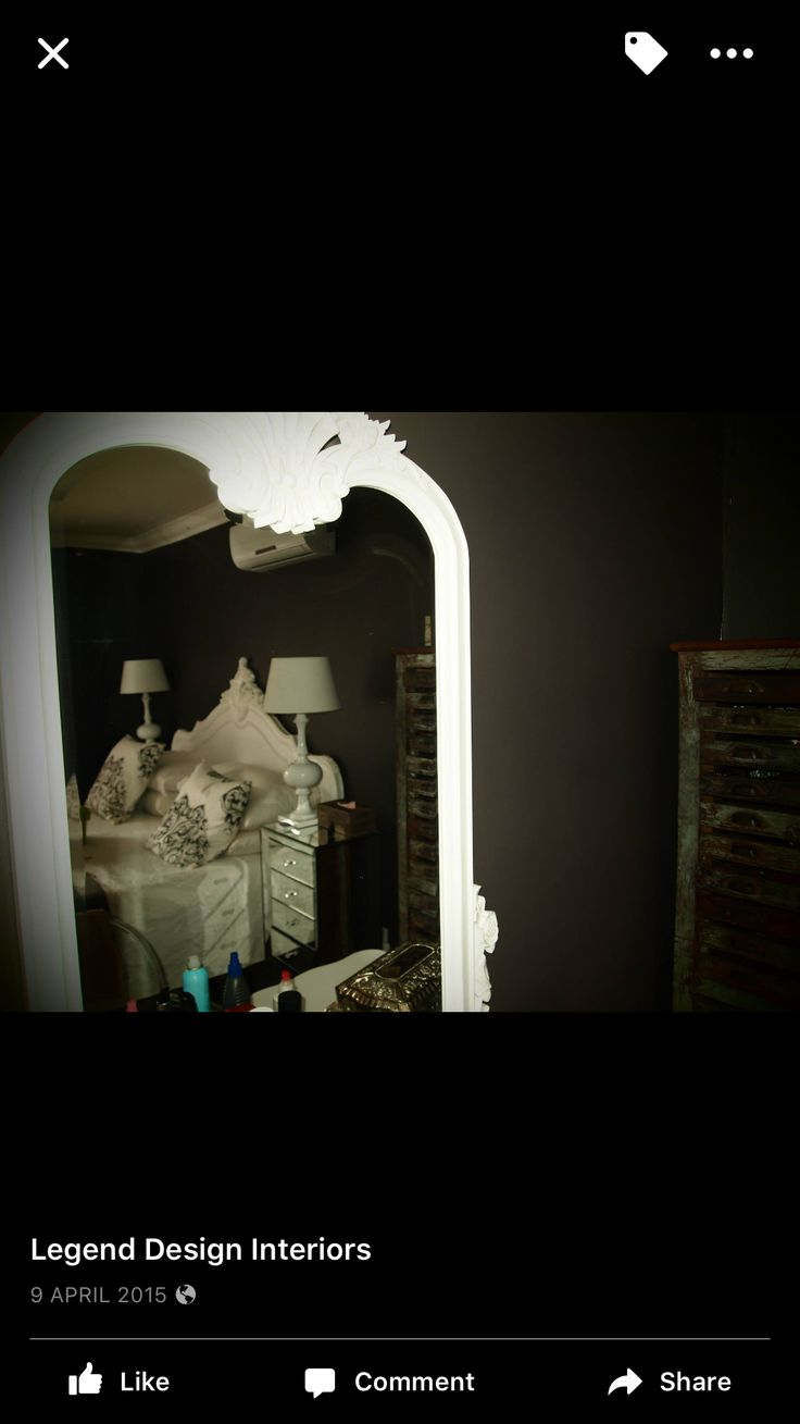 French white mirror reflecting Monochrome french main bedroom