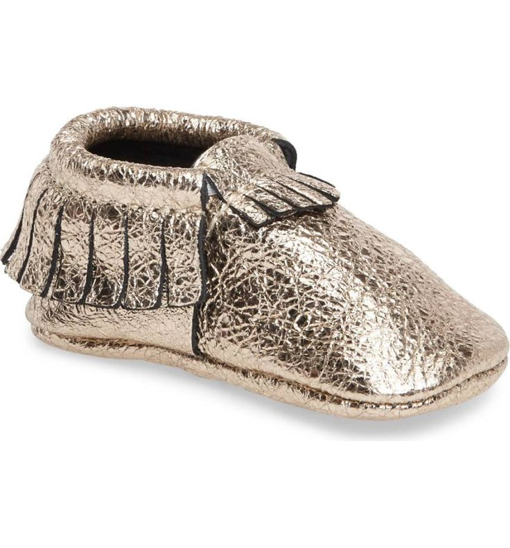 Perfectly sized for little feet, a metallic print defines this fringed moccasin handmade in the USA.