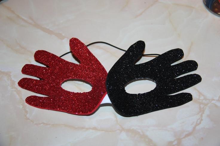 Handprint Mardi Gras Mask (plain white mask + 2 sheets of self-stick glitter foam + x-acto knife ... + Mod Podge to reinforce)