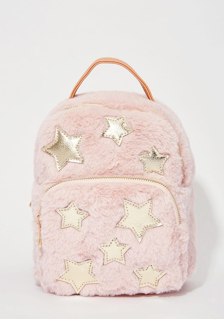 I Need Space Mini Backpack cuz you just wanna float among the starz. This mini backpack has a pink fuzzy exterior, two zippered pockets, and gold stars on the front.