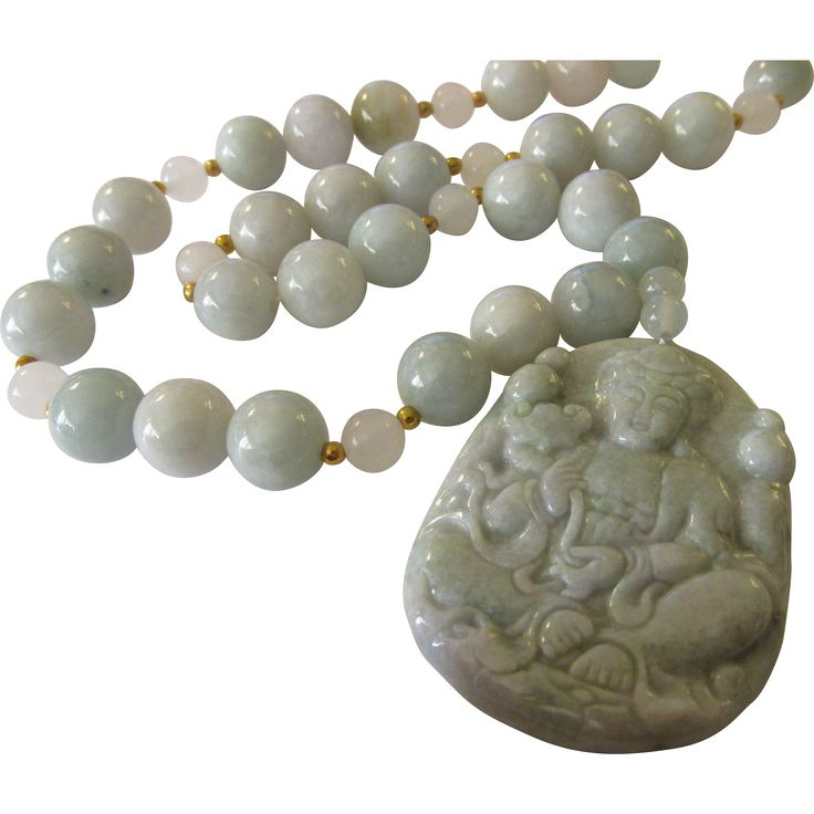 This all-jade necklace uses top quality jadeite jade components. It is comprised of a 2 long pendant of Kwan Yin sitting in lotus position as she