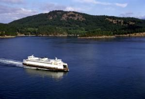 Washington State Ferry Passing Between Islands, San Juan Islands - Washington State Ferry Passing Between Islands (J. Poth/Washington State Tourism)