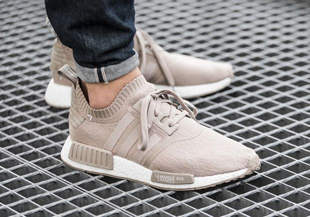 A new adidas NMD Runner PK will hit European retailers on June 10th featuring a new Beige colorway and French callouts throughout the model.