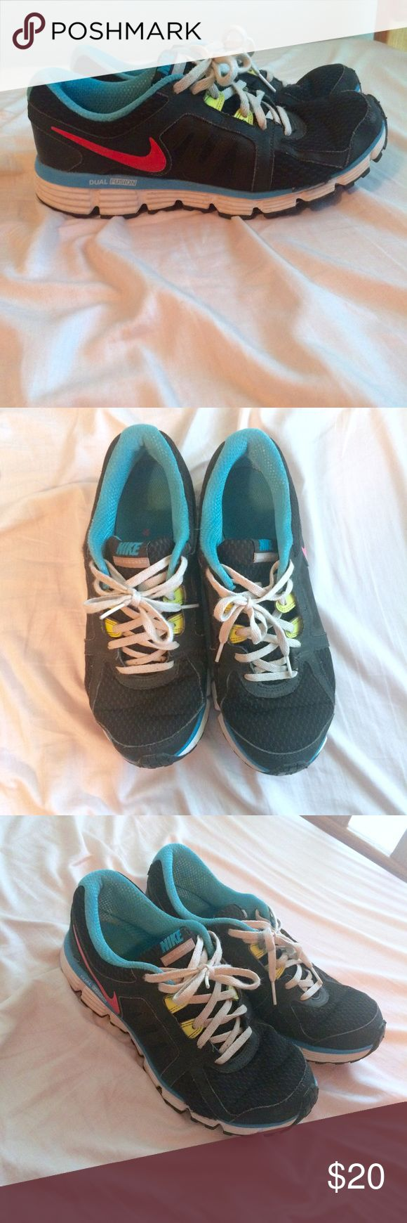 Nike Dual Fusion Multicolored Neon Sneakers Quite worn but still have lots of life. Has a tear near the pinky toe on the right shoe. Very cute Neon accents on shoes. Nike Shoes Athletic Shoes