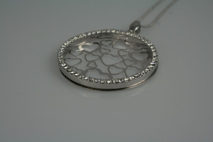 A personal favorite from my Etsy shop https://www.etsy.com/ca/listing/114449311/stylish-pendant-and-chain-with-hearts