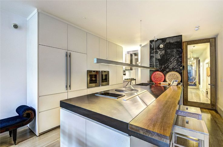 Keuken 'Madrid'  Gaggenau apparatuur, RVS werkblad, Eikenhouten barblad, teppan yaki plaat   interieur & keukens  www.KeukenOffertes.nl  ©2015 KvK: 61826693  @ KeukenOffertes op Twitter