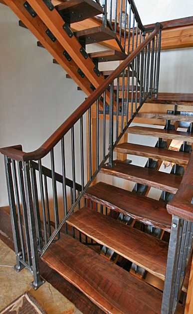 A Quot Floatin Quot Walnut Staircase Combines Hand Forged Steel