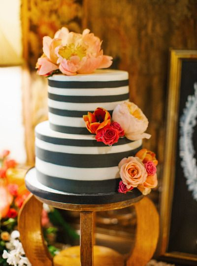 Black and white striped wedding cake: http://www.stylemepretty.com/florida-weddings/winter-park-fl/2014/10/15/romantic-winter-park-wedding-at-casa-feliz/ | Photography: Shannon Lee Miller - http://www.shannonleemiller.com/