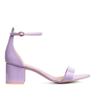 Light purple. Sandals with an adjustable ankle strap with metal buckle. Faux leather lining and insoles and rubber soles. Covered heels, height 2 1/4 in.