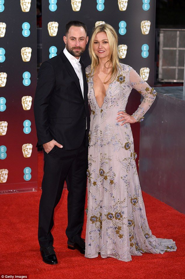 Happy duo: Julia and her fiance Preston J Cook, pictured at the BAFTAs in February, have been together since 2015