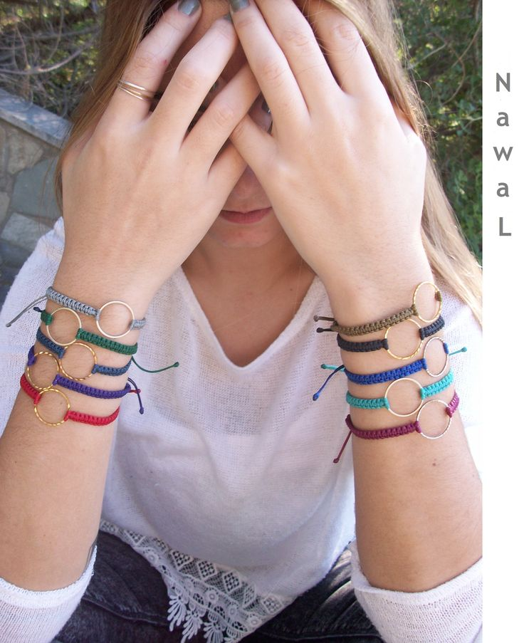 Handmade colorful macrame bracelets, with a hoop in the middle....