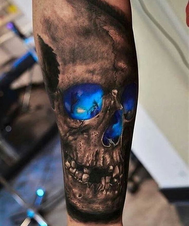 Blakc and grey designed Skull tattoo, w/ Bright sapphire blue eyes/nose from inside!