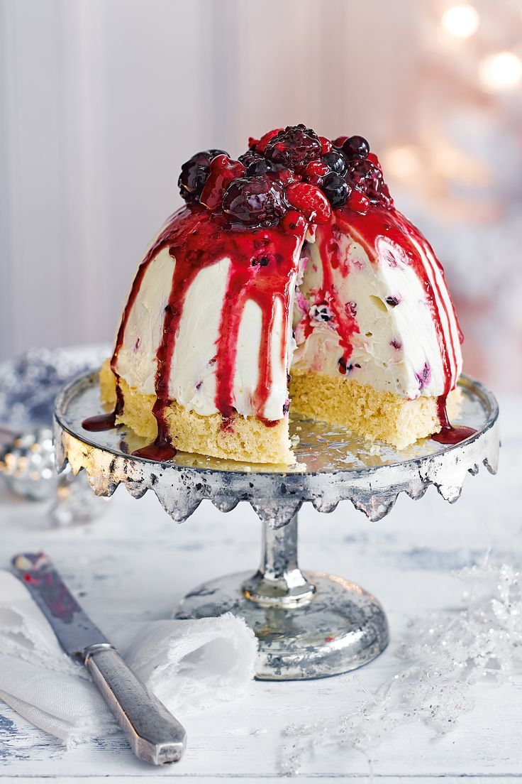 This stunning dessert tastes as heavenly as it looks. A dome of creamy white chocolate mousse sits atop a light sponge base and is topped with an array of summer fruits and a cascading fruit coulis. | Tesco