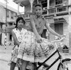 Suriname, 1959, meisjes op fiets