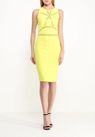 Желтое платье, средней длинны с перфорацией на груди и в облости живота.