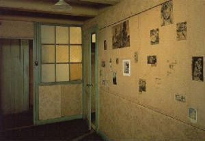 Anne Frank Huis, Anne's room. The photos on the wall are what remain of Anne's collection that she placed on the wall herself.