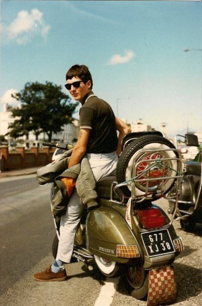 Real cool dude in great Vespa style.