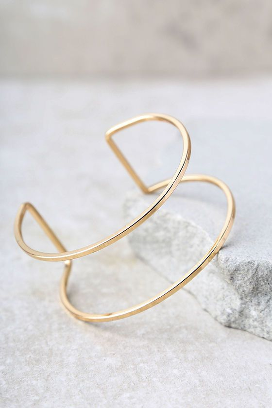 """The Current Events Gold Cuff Bracelet is up-to-speed with all the latest trends! Shiny gold forms this minimalist cuff bracelet. Cuff measures 1"""" tall with a 3.5"""" diameter. Adjusts slightly."""
