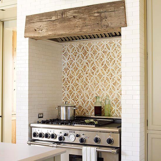 Tucked into a niche, this range looks as if it sits inside a former cooking fireplace.