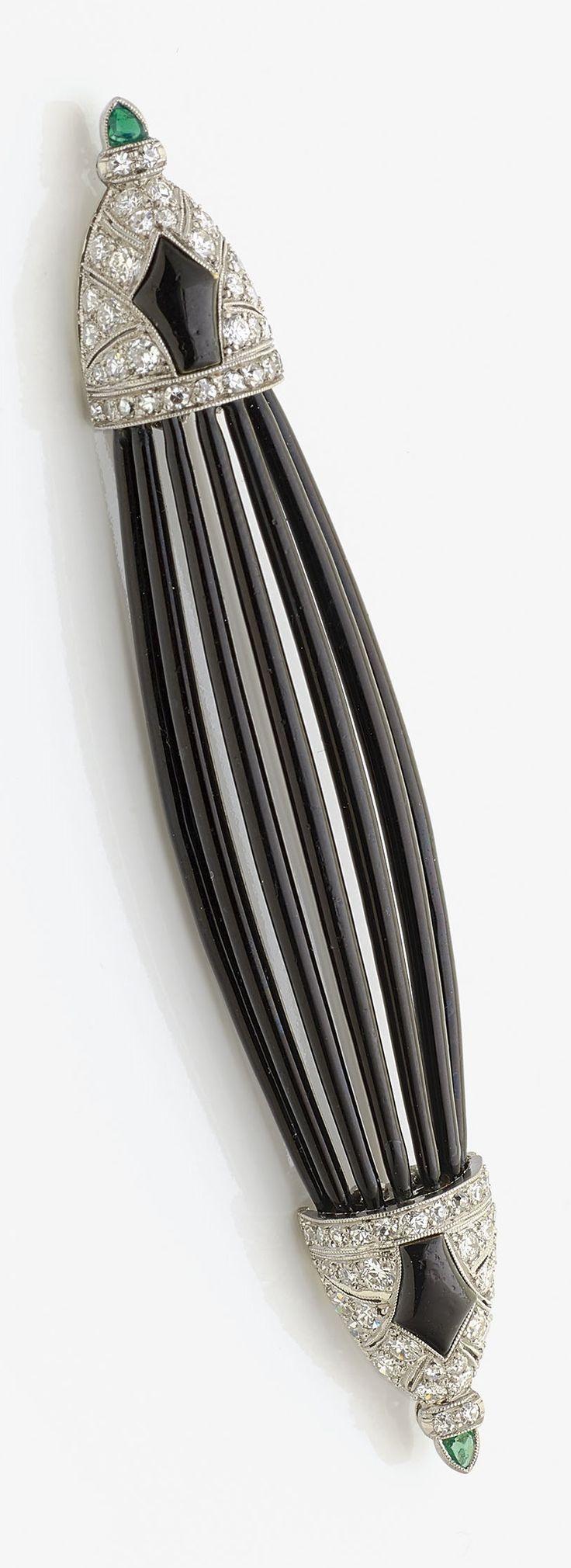 AN ART DECO PLATINUM, ENAMEL, DIAMOND AND EMERALD BROOCH, ENGLISH, ABOUT 1925. Measurements: 8.4 x 1.5 - 2.7 cm. #ArtDeco