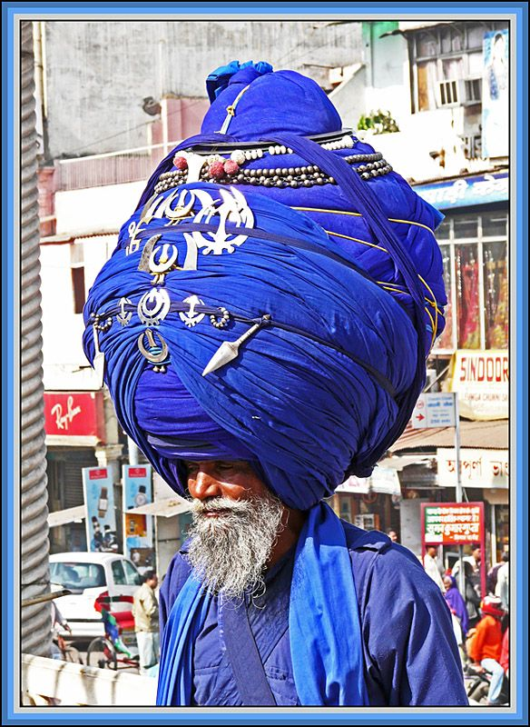 ✯ Kesh is the uncut hair of a Sikh male. A turban (Dastaar) is worn to protect the Kesh and guard the Dasam Duaar (10th Gate) - the spiritual opening at the top of the head. A turban should be understood as a spiritual crown - as well as a tourist attraction - when photographed at the Sri Ganj Gurdwara in Delhi. Copyright: Ken Boulter ..Sardonik..✯