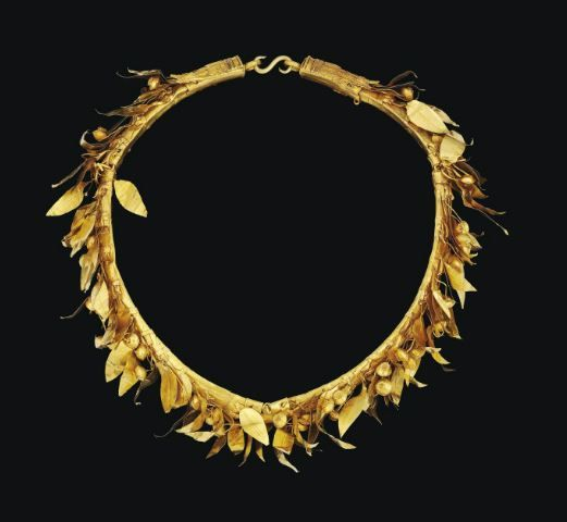 Greek gold Myrtle wreath, Hellenistic period, 3rd-2nd century B.C. Composed of four hinged gold bands, rounded on the exterior, flat on the interior, each decorated with long spear shaped Leaves, with a central midrib  with fruit on delicate wire stems, each with a detailed filigree calyx, three acanthus leaves with serrated edges and twisted wire borders, and two laurel leaves with beaded borders, with modern loops and an S-clasp closurem,  21 cm diameter. Private collection