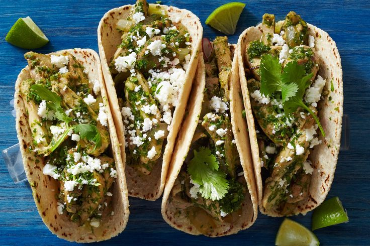 Rick Bayless' Chicken Tacos ½ head of garlic, separated into cloves 5 serrano chiles, stems removed 2 cups loosely packed cilantro, chopped (plus more for garnish) 2 cups loosely packed flat-…