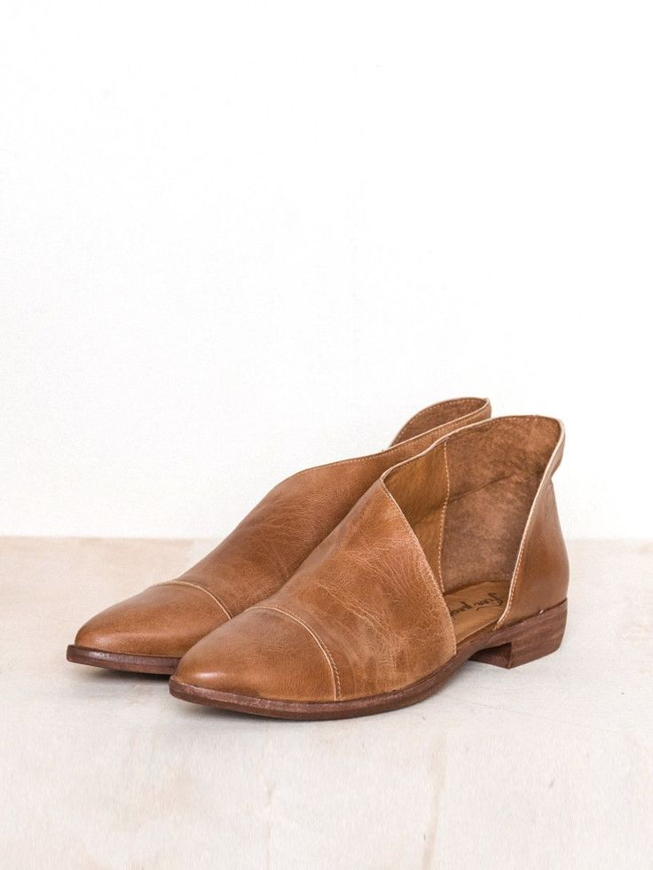 """Favorite leather flats feature side cutouts with a slightly stacked heel. Artisan crafted from fine leathers and premium materials. By Free People 1"""" Heel Height 100% Leather"""