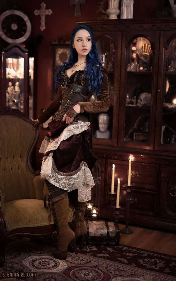 Velvet and Lace - Blue haired steampunk girl from steamgirl.com wearing a velvet ruffle skirt with lace trim - For costume tutorials, clothing guide, fashion inspiration photo gallery, calendar of Steampunk events, & more, visit SteampunkFashionGuide.com