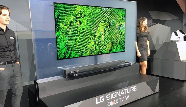 CES 2017, LG presenta il tv che si appiccica alla parete http://www.sapereweb.it/ces-2017-lg-presenta-il-tv-che-si-appiccica-alla-parete/        Las Vegas – È talmente sottile da sembrare un tutt'uno con la parete: è l'ultimo TV OLED presentato da LG sul palco del CES, si chiama Signature OLED TV W7 ed è un pannello che arriva fino a 65 pollici di diagonale e misura appena 2,57 millimetri di spessore. Talmente leggero da poter es...