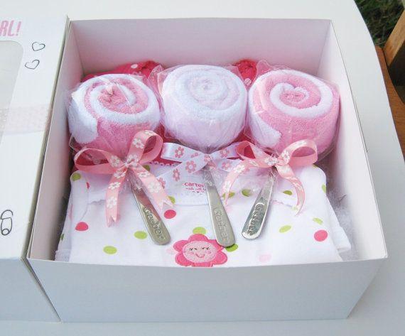 bakery box +  2 - Onesies  3 - baby Spoons  6 - baby washcloths
