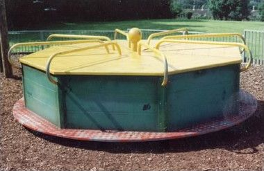 Roundabouts. these type got banned as many kids got there ankles trapped underneath & broken!