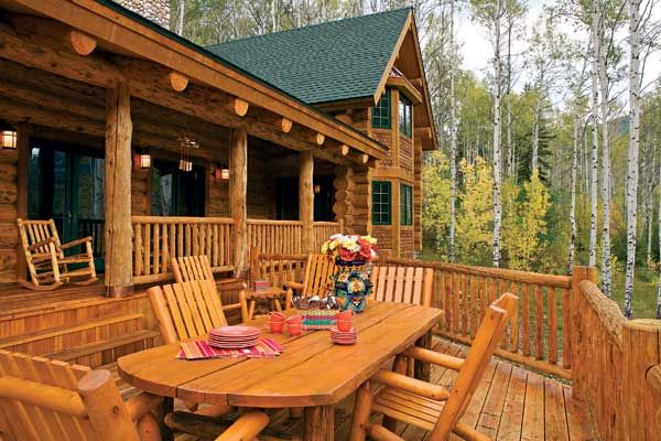 Pine patio furniture coordinates with the redwood step for Log home decks