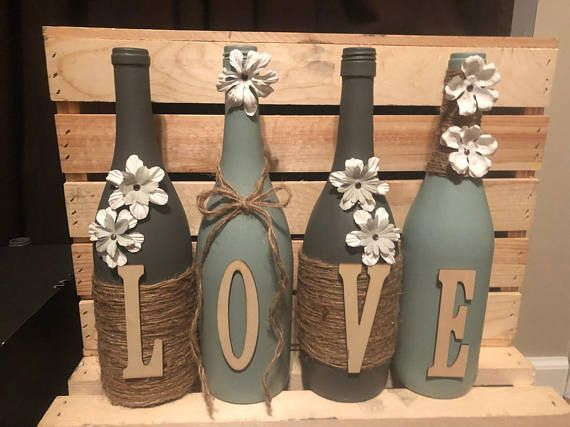 Hand painted decorated wine bottles. Pictured is either home or love but can also do any wording you would like (price varies) #DIYHomeDecorWineBottles